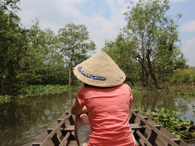 Woman on boat with Vietnamese hat