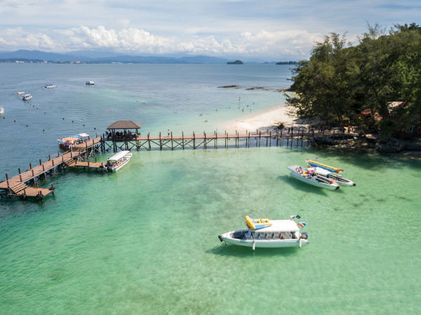 View across the pier and the beach of Gaya Island