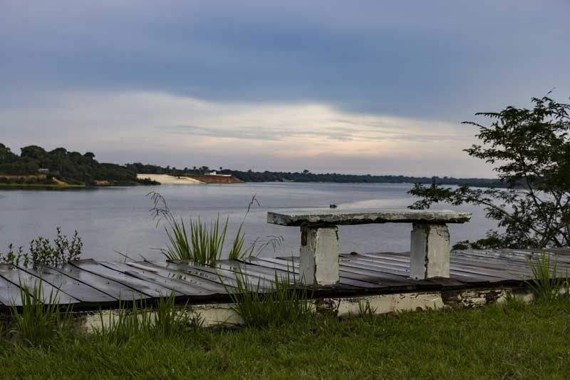 The Amazon river with a bench
