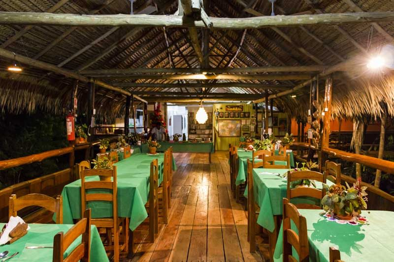 A dining room in the Amazon Lodge