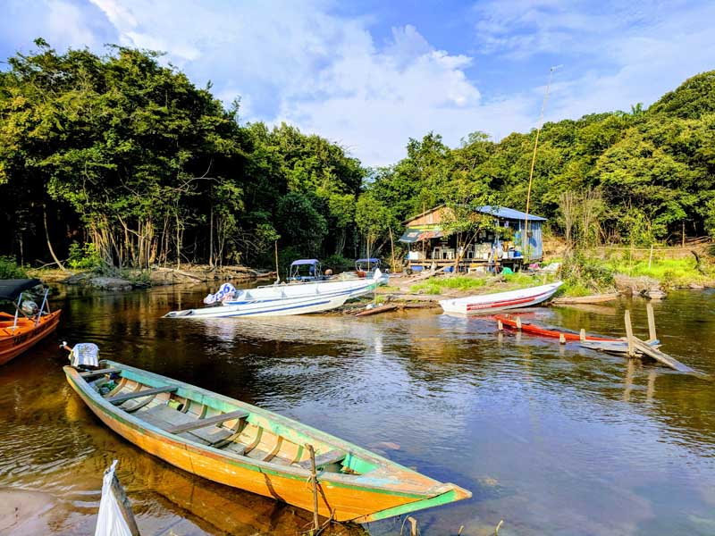 Entrance to the amazon rainforest with boats