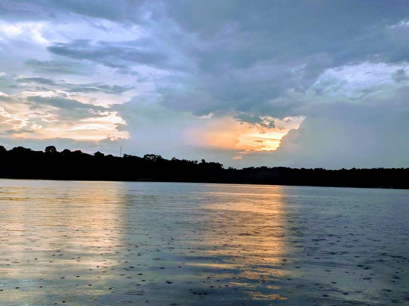Amazon river with reflected clouds