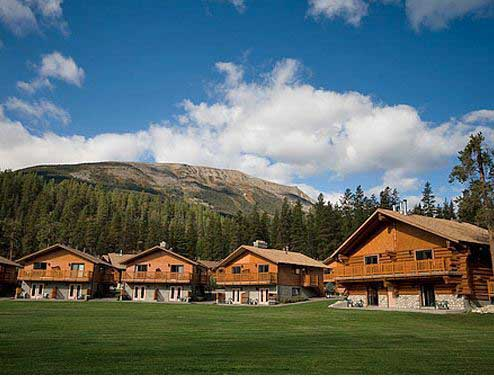 lodges in a row with mountain and gras