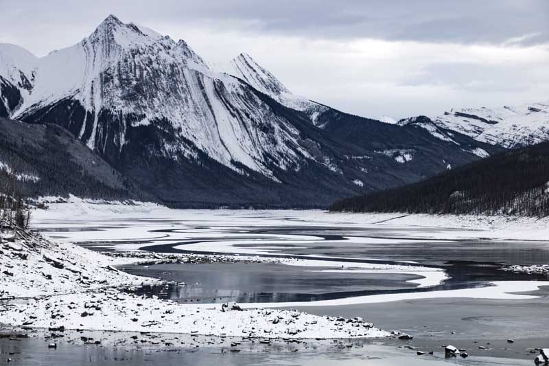 Snowy mountain and icy lake