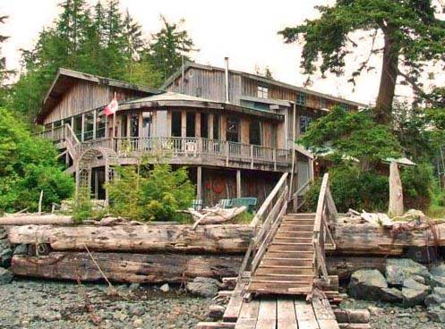 Wooden cabin with stairs by water