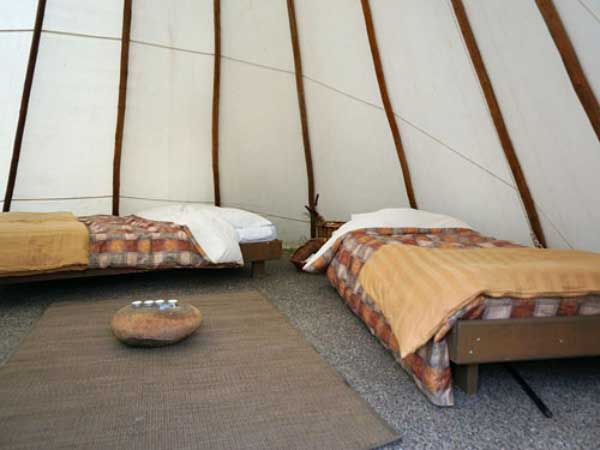 two beds inside a tipi