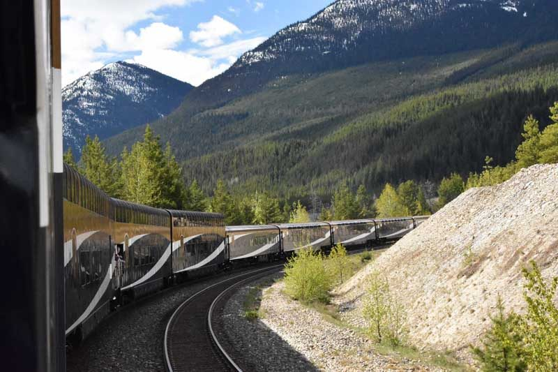 Train on tracks with mountains