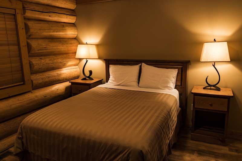 Hotel room with bed and lamp
