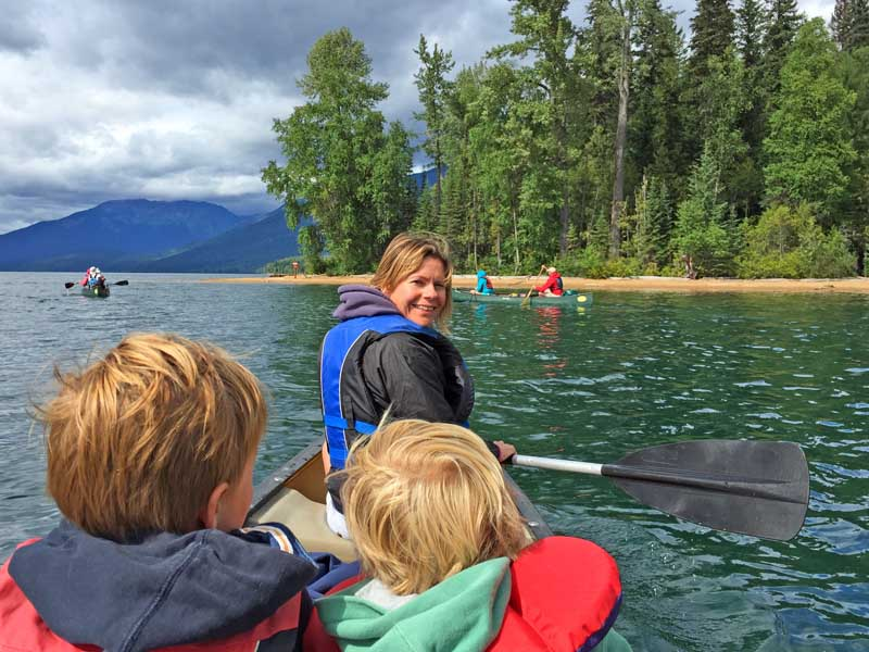 Family on canoes in lake
