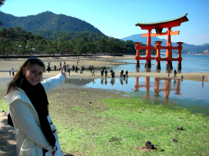 Woman standing in from of the Torii Gate