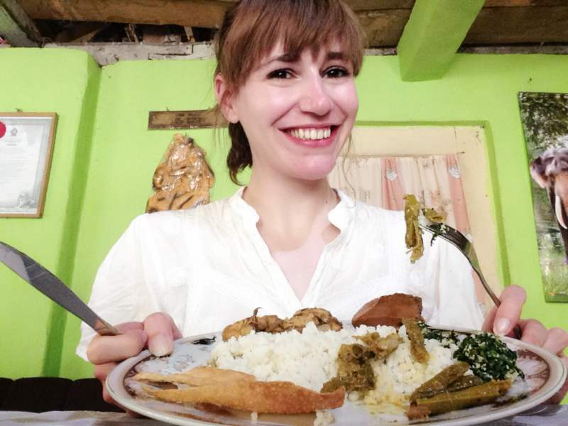 Woman showing off home cooked cuisine