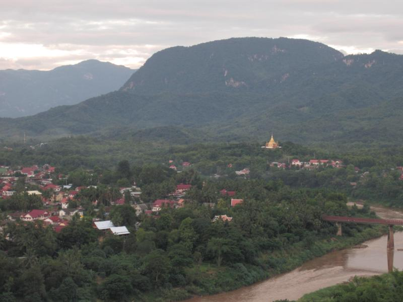 Luang Prabang city with golden temple in the distance