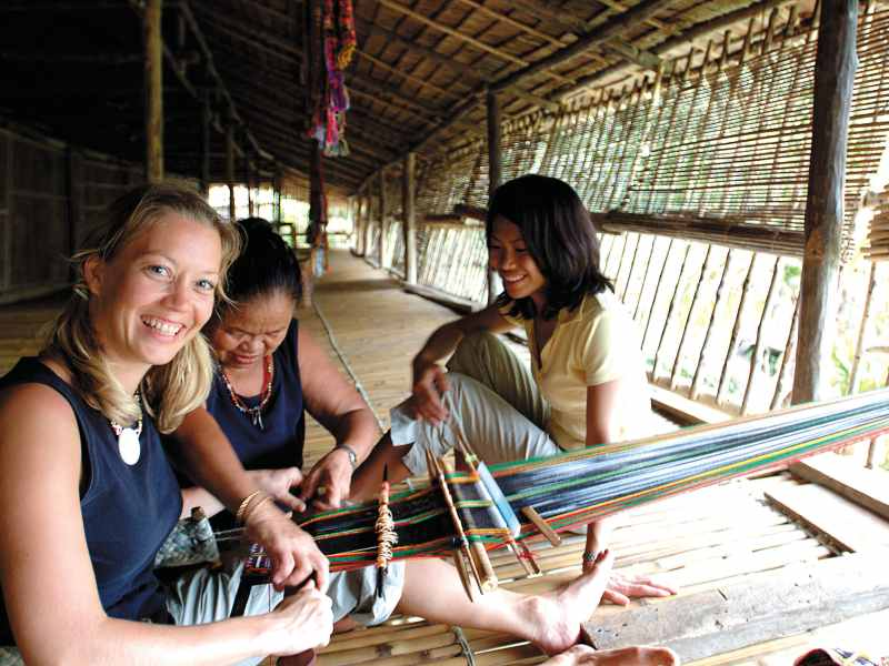 Local women making clothes with local tribe