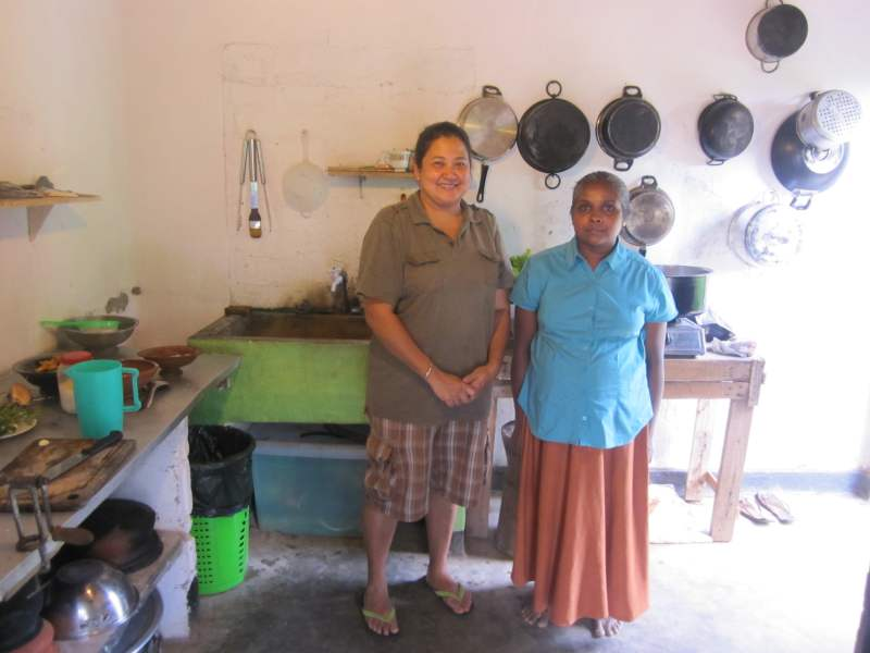 Local women standing infrot of kitchen