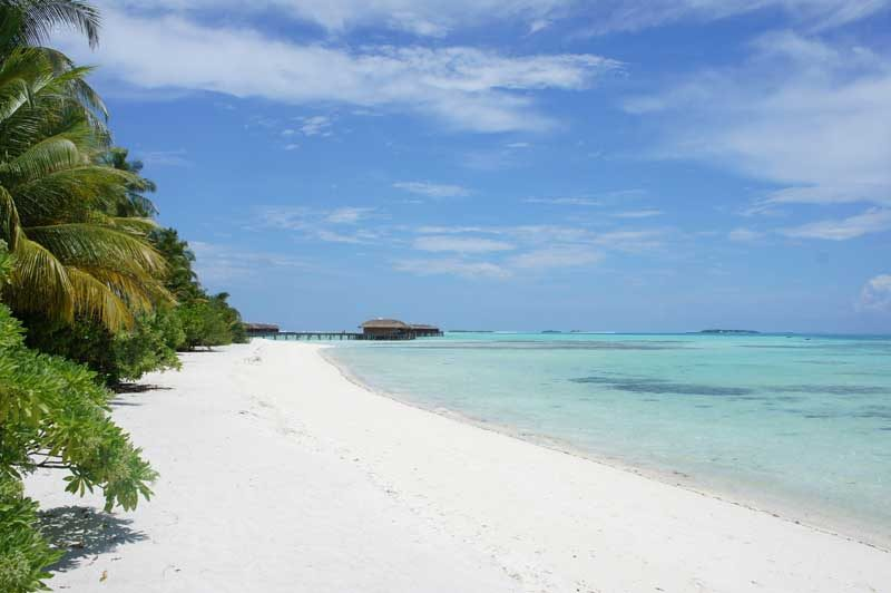 White sand beach with tropical blue sea