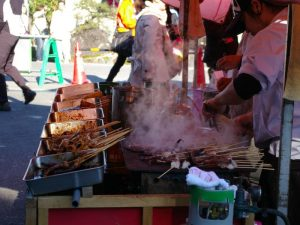 Meat kebabs being cooked on street stall