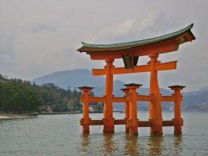 Red torri gate in the middle of water