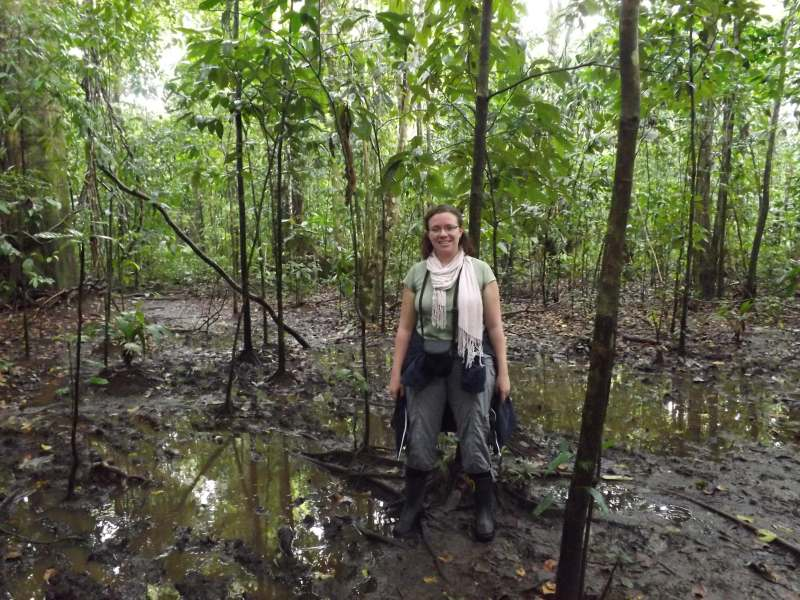 Woman standing in jungle