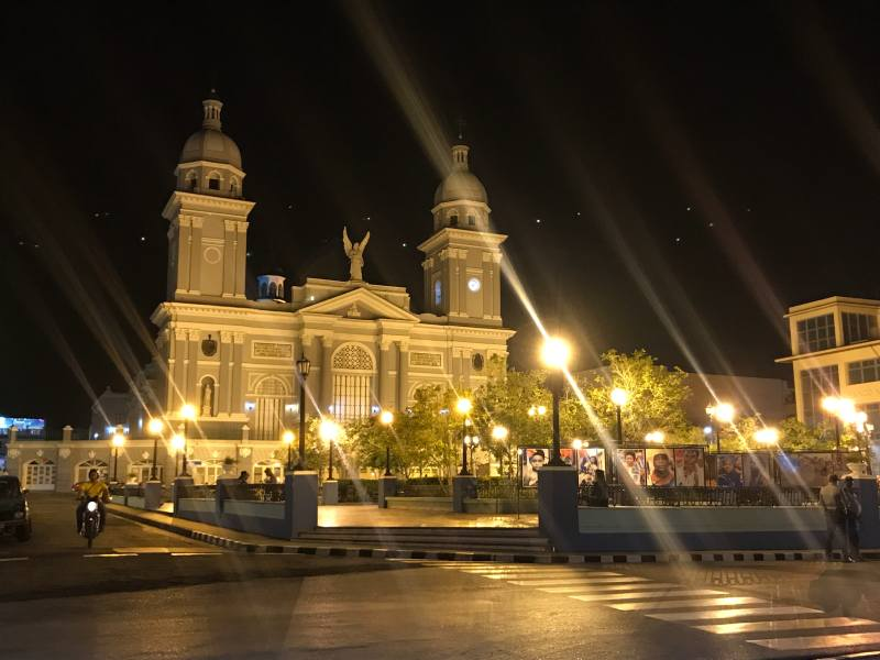White building at night with bright lights