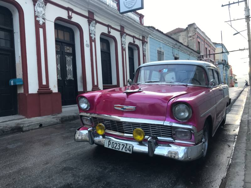Pink classic car in Cuban street