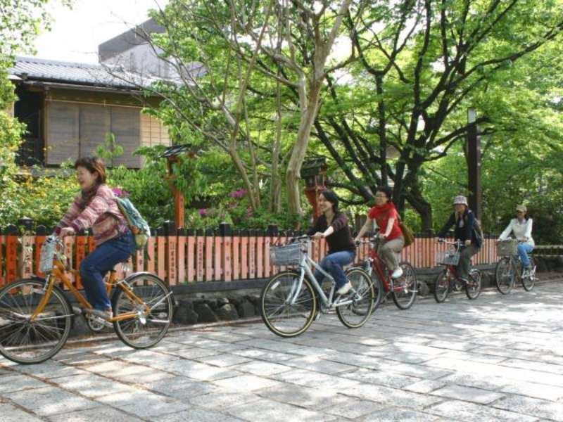 Row of locals riding bike