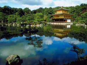 Golden temples surrounded by lake