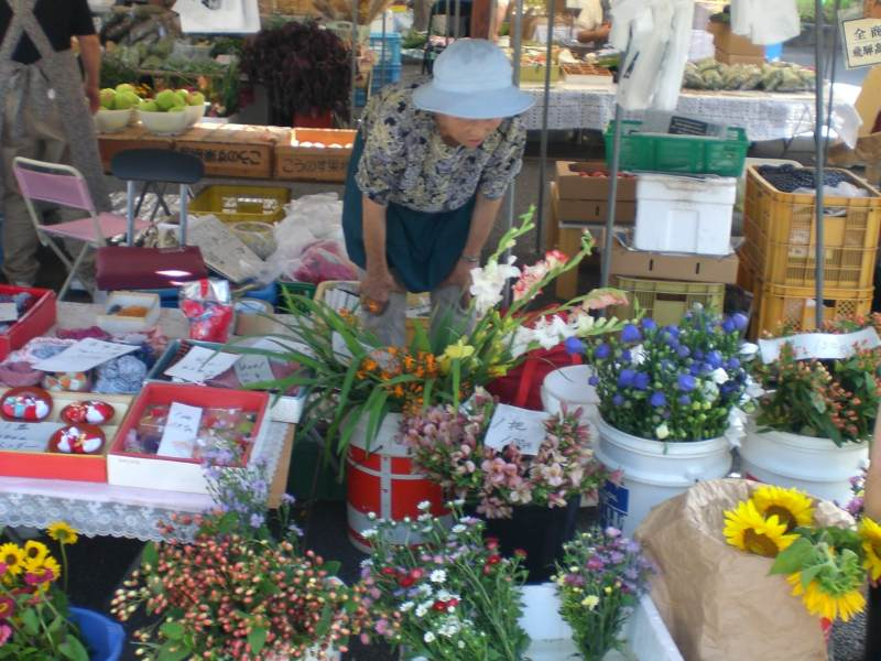 Local woman selling flowers at market