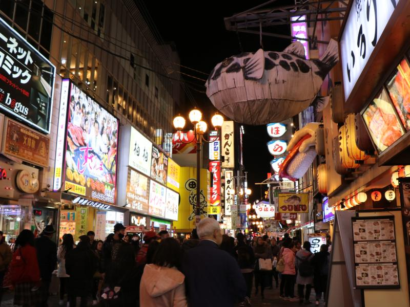 Floats and neon lights in Japan district