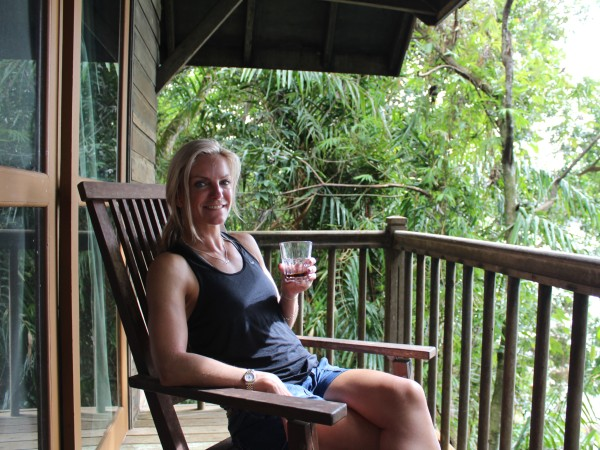 Woman on the balcony of one of the treehouses on the Damai Peninsular
