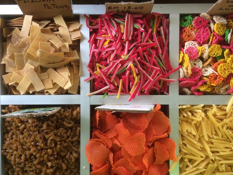 Brightly colour pasta at market