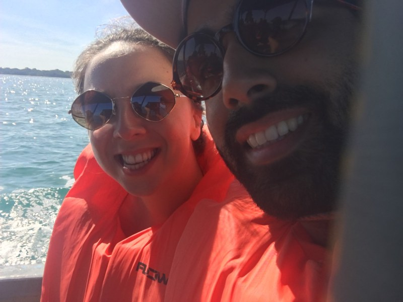 Couple on boat with lifejacket