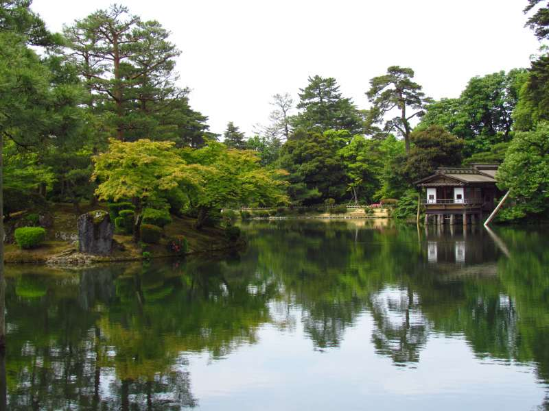 Japanese garden with big lake reflecting trees
