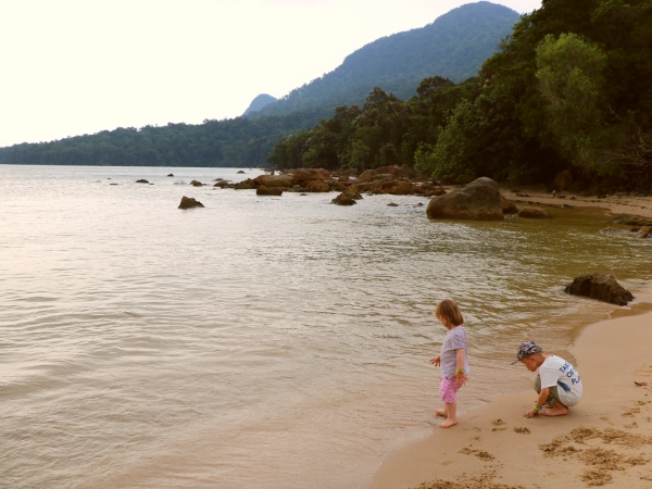 Kids playing on the beach in Damai Peninsular