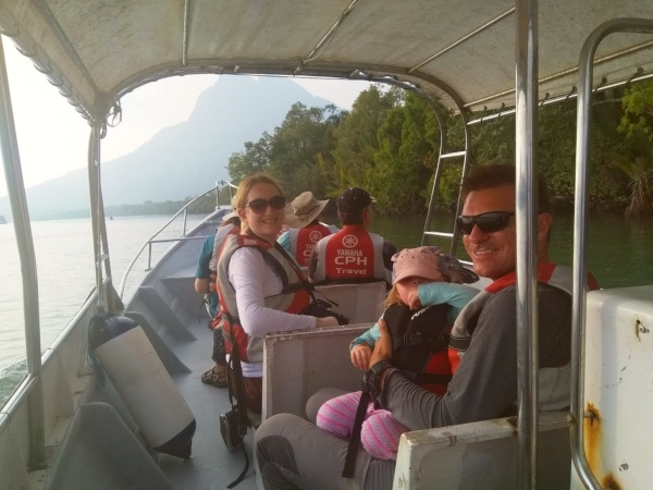 Family heading out on a boat tour on the Santubong River