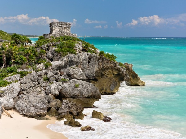 Ruins on side of bright blue ocean