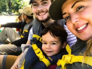 Family with life jackets in boats