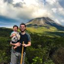 Family in front of volcano