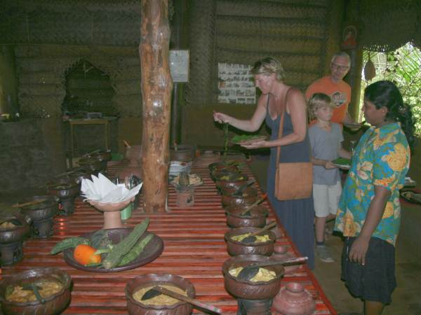 Family cooking curry with local