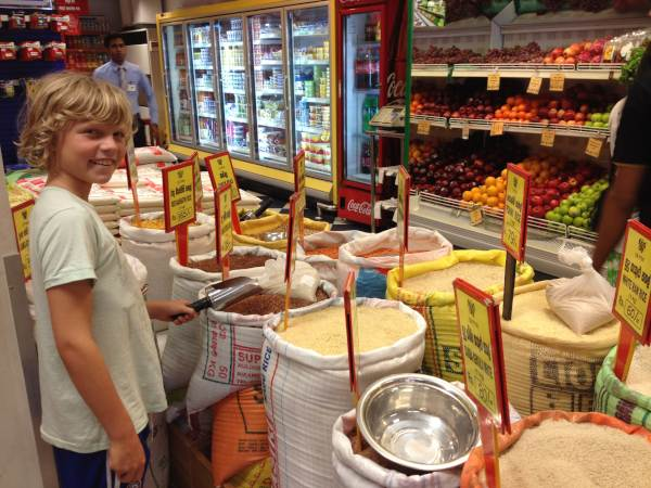 Boy picking spices at market