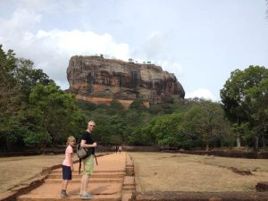 Man with child against Sigraya Rock