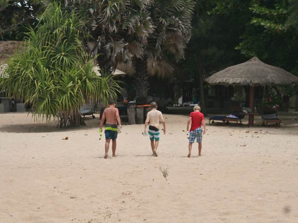Young boys walking on beach