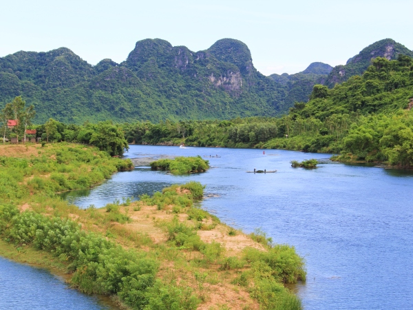 river by limestone outcrops in phong nha national park