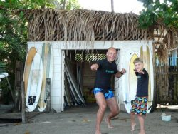 Father and Son practicing to surf