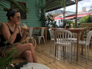 Woman sipping drink at cafe