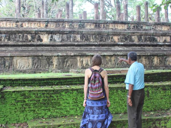 Woman and man looking at temple
