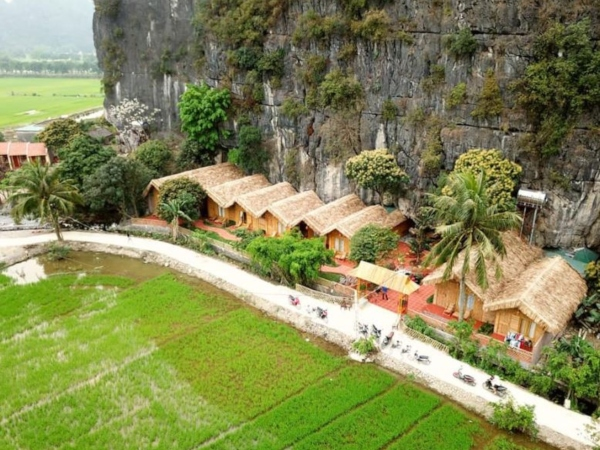 thatched bungalows in rice fields tam coc vietnam