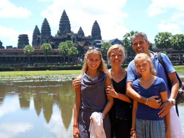 Family standing in front of Angkor Watt