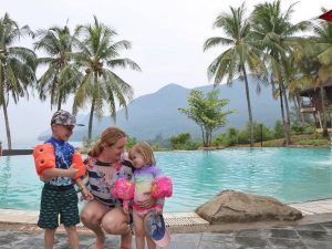 Family standing by the pool
