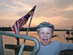Boy smiling with flag