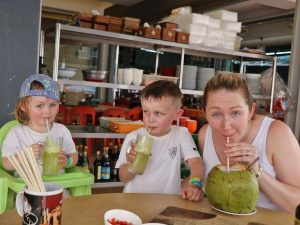 Woman and kids sipping drink